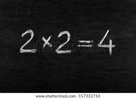 Figures written by chalk on a blackboard - stock photo