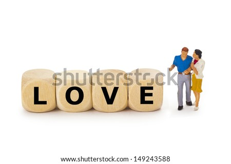 Figurine from a couple with wooden cubes on white background - stock photo