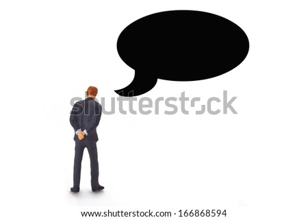 Figurine from Manager with speech bubble on white background - stock photo