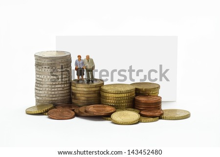 Figurine from senior couple with eruo coins on white background - stock photo