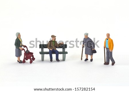 Figurine from seniors on bright background - stock photo