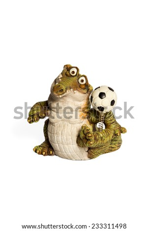 Figurine green crocodile with a soccer ball on the spring isolated on white background - stock photo