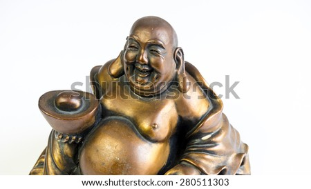 Figurine of funny, laughing and cheerful golden copper Buddha or Hotei. Concept of fortune, prosperity and Chinese God of Wealth. Isolated on white.