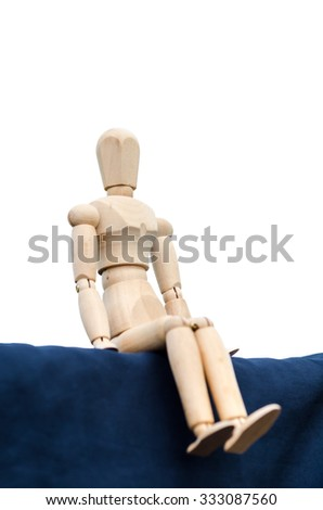 Figurine of wooden, vintage wooden doll (depression) - stock photo
