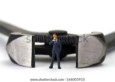 Figurine with pincers on bright background - stock photo