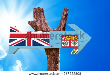 Fiji Flag wooden sign with sky background - stock photo