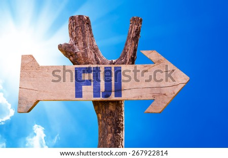 Fiji wooden sign with sky background - stock photo