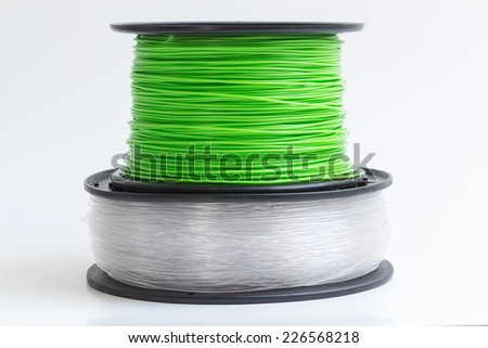 Filament for 3D Printer crystal clear and bright green against a bright background.