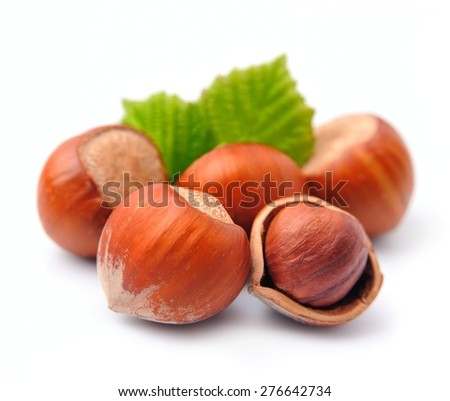 Filbert nuts with leaves close up on white - stock photo