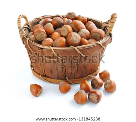 Filberts in the basket isolated on white background - stock photo