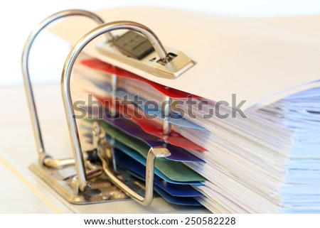 file folder macro with some details and papers - stock photo