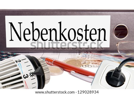 file folder with the german word additional costs / additional costs - stock photo