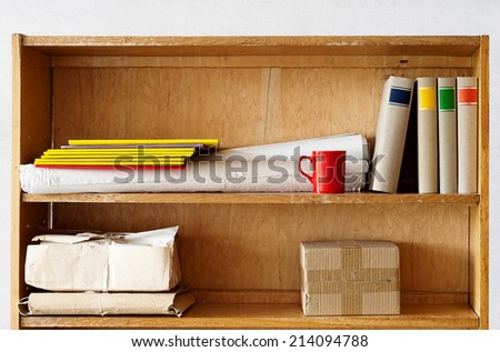 file folders, books and other stuff standing on the shelve - stock photo
