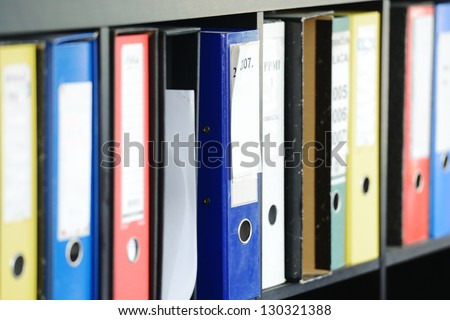 File folders, standing on the shelves - stock photo