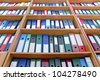 file folders, standing on the shelves in the background - stock photo