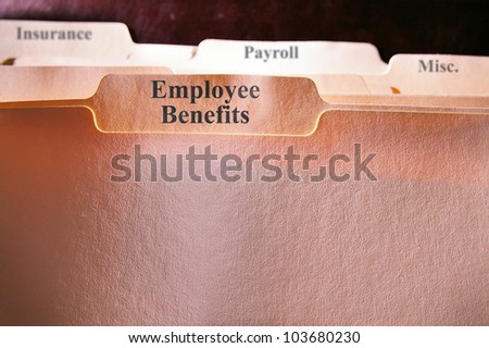 file folders with Employee Benefits text - stock photo