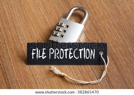 File Protection words written on tag label with combination padlock - stock photo