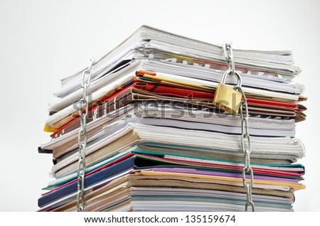 File stack locked with chain and padlock - stock photo