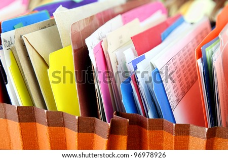 Files. Row of folders in expending file pockets