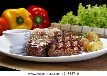 filet mignon with baked potato rice and vegetables - stock photo
