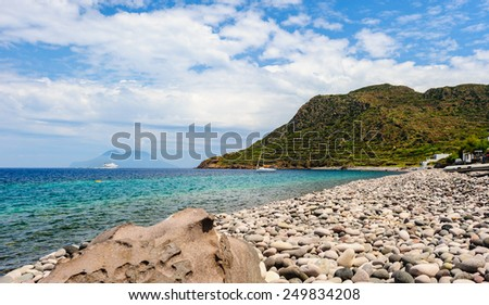 Filicudi pebble shoreline near port, Aeolian islands, Sicily, Italy. - stock photo