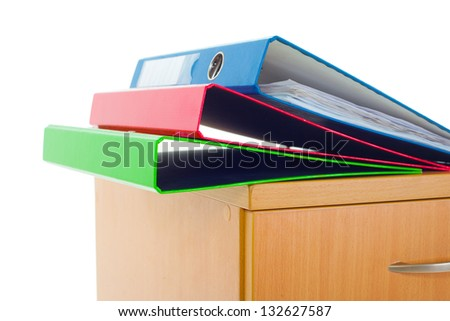 Filing cabinet and folders isolated over white background