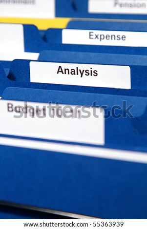 Filing cabinet full of business folders and documents
