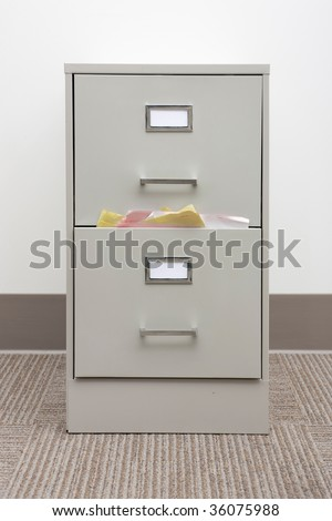 filing cabinet stuffed with papers - stock photo
