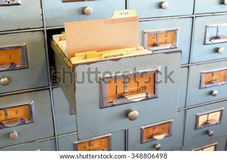 Filing cabinet with single document file in open drawer. Office concept.  - stock photo