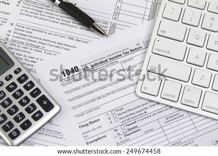 Filing taxes online using a computer - stock photo