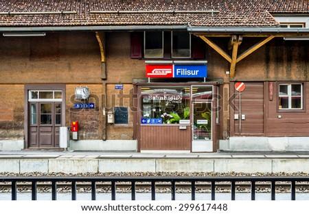 FILISUR, SWITZERLAND - DECEMBER 16, 2015 : Filisur train station, Switzerland is the part of Rhaetian Railway - the largest train line in Swiss Alps and UNESCO World heritage. - stock photo