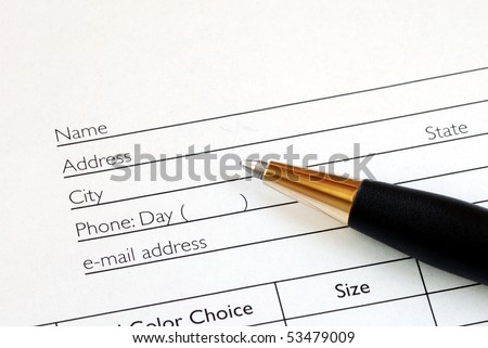 Fill in the name and address in an order form - stock photo