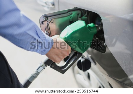 Fill the gas tank eco car self service - stock photo