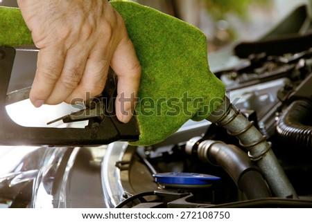 Fill up the gas tank, eco energy concept  - stock photo