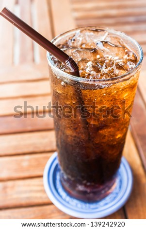 Filled glass with fresh ice cola drink - stock photo
