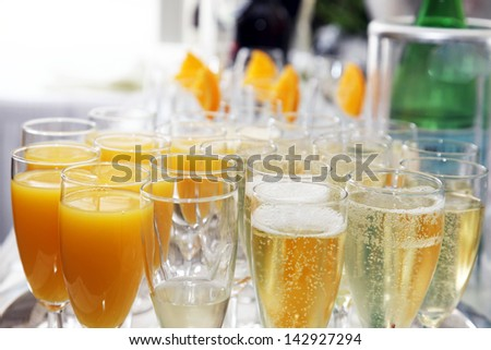 Filled glasses for aperitif are waiting on a tray - stock photo