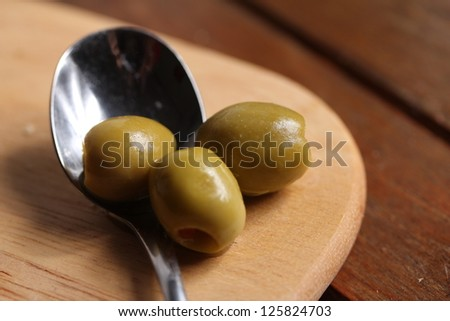 filled olives on a spoon