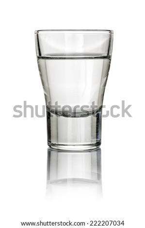 Filled Shot Glass on a white background - stock photo