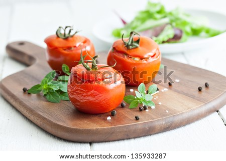filled tomatoes with rice and onions