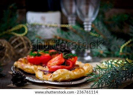 fillet of a salmon and vegetables  in puff pastry on a New Year's holiday table. selective focus - stock photo