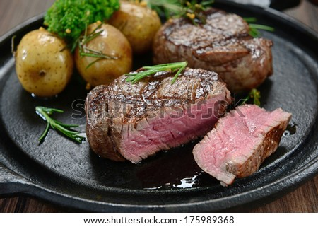 Fillet of beef and potatoes - stock photo