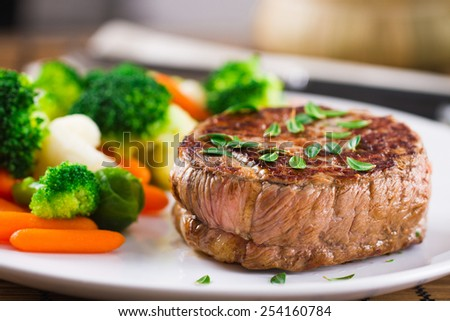 Fillet of beef with mixed vegetables - stock photo