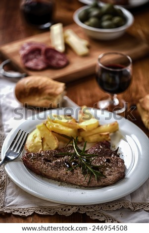Fillet of beef with potatoes - stock photo