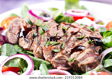 Fillet of beef with salad - stock photo