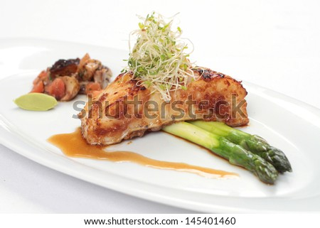 Fillet of cod in glazed sauce in Western fine dining presentation - stock photo