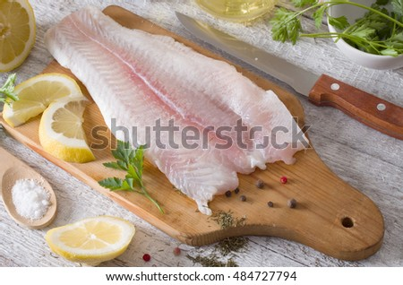 Fillet of fish on a kitchen board