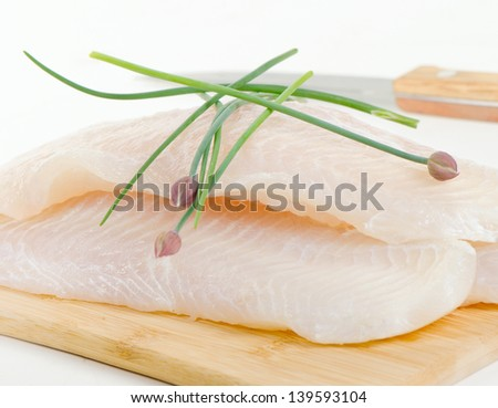 Fillet of fresh fish with herbs. Selective focus - stock photo