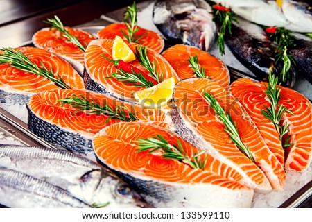 Fillet of red fish served with lemon and rosemary - stock photo