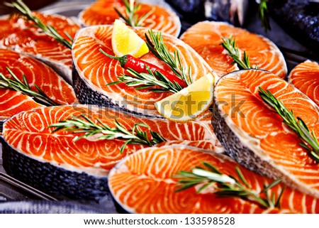 Fillet of salmon served with lemon and rosemary - stock photo