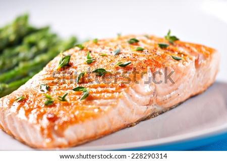 Fillet of salmon with asparagus - stock photo